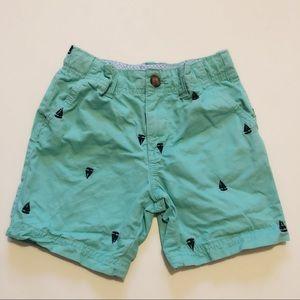 Carters adjustable wait green sailor shorts.